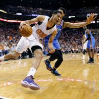 Photo -  Phoenix Suns guard Gerald Green, front, drives the baseline as Oklahoma City Thunder guard Jeremy Lamb defends during the first half of an NBA basketball game Sunday, April 6, 2014, in Phoenix. The Suns won 122-115. (AP Photo/Matt York)