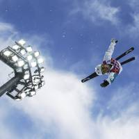 Photo - Australia's Lydia Lassila jumps during women's freestyle skiing aerials training at the Rosa Khutor Extreme Park, at the 2014 Winter Olympics, Friday, Feb. 14, 2014, in Krasnaya Polyana, Russia. (AP Photo/Greg Baker)