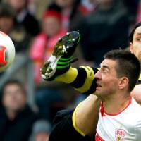 Photo - Dortmund's Neven Subotic, behind, and  Stuttgart's Vedad Ibisevic, front, challenge for the ball during the German Bundesliga soccer match between VfB Stuttgart and Borussia Dortmund in Stuttgart, southern Germany, Saturday March 30, 3013. (AP Photo/dpa,Marijan Murat)