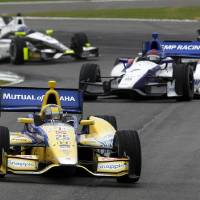 Photo - Marco Andretti (25) leads a pack of cars out of turn 16 during the Indy Grand Prix of Alabama auto race on Sunday, April 27, 2014, in Birmingham, Ala. (AP Photo/Butch Dill)