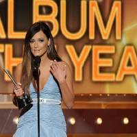 Photo -  Kacey Musgraves accepts the award for album of the year at the 49th annual Academy of Country Music Awards at the MGM Grand Garden Arena on Sunday, April 6, 2014, in Las Vegas. (AP)