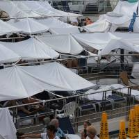 Photo - Chris and Robin Carpenter, of Edmond, along with some family members and friends, spent much of their five days stranded at sea beneath tents made from bed sheets. On top of them they wrote,