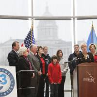 Photo - State Superintendent Janet Barresi, at the podium, speaks at a No Child Left Behind waiver press conference, Thursday, February 9, 2012.   In the background are students and school administrates.   Photo by David McDaniel, The Oklahoman