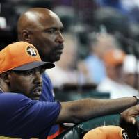 Photo - Houston Astros manager Bo Porter, left, and first base coach Dave Clark watch the third inning of an exhibition baseball game against the Chicago Cubs, Saturday, March 30, 2013, in Houston. (AP Photo/Pat Sullivan)