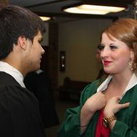 Photo -  Norman North High School senior Madison Crider and Norman High School senior Blake Goss keep each other company while waiting for a baccalaureate service at First Baptist Church. PHOTO BY LYNETTE LOBBAN, FOR THE OKLAHOMAN