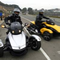 Photo - In this Feb. 9 2007 file photo provided by Can-Am Spyder, test riders pull out onto the highway for a test ride at the unveiling of the 2008 Can-Am Spyder roadster in Del Mar, Calif. U.S. safety regulators are investigating two reports of fires in Can-Am Spyder three-wheeled motorcycles. The probe announced Friday, Aug. 8, 2014 covers about 52,000 motorcycles from the 2008 through 2014 model year. (AP Photo/Can-Am Spyder, Denis Poroy, File)