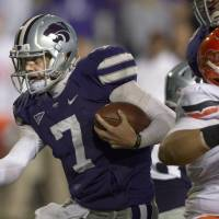 Photo -   Kansas State quarterback Collin Klein (7) runs for a first down during the first half of an NCAA college football game against Oklahoma State in Manhattan, Kan., Saturday, Nov. 3, 2012. (AP Photo/Orlin Wagner)
