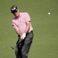 Photo - Miguel Angel Jimenez, of Spain, hits to the second green during the first round of the Masters golf tournament Thursday, April 10, 2014, in Augusta, Ga. (AP Photo/Chris Carlson)