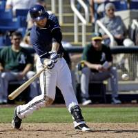 Photo - Milwaukee Brewers' Ryan Braun hits a home run during the eighth inning of an exhibition baseball game against the Oakland Athletics Wednesday, March 5, 2014, in Phoenix. (AP Photo/Morry Gash)