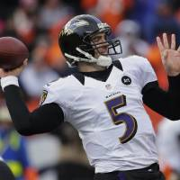 Photo - Baltimore Ravens quarterback Joe Flacco passes against the Denver Broncos in the second quarter of an AFC divisional playoff NFL football game, Saturday, Jan. 12, 2013, in Denver. (AP Photo/Charlie Riedel)