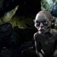 Photo - the character Gollum, voiced by Andy Serkis, is shown in a scene from the fantasy adventure