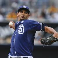 Photo - San Diego Padres starting pitcher Tyson Ross throws against the New York Mets in the first inning of a baseball game Saturday, July 19, 2014, in San Diego.  (AP Photo/Lenny Ignelzi)