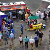 Photo - Mobile food trucks gather in Oklahoma City in this 2010 file photo. The concept of mobile food vending dates to chuck wagons that rolled in the wake of cattle drives across the country's prairies. PHOTO BY CHRIS LANDSBERGER, THE OKLAHOMAN ARCHIVEs