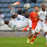 Photo - Cameroon's Webo Achille scores during their friendly soccer match against Macedonia in Kufstein, Austrian province of Tyrol, on Monday, May 26, 2014. (AP Photo/Kerstin Joensson)