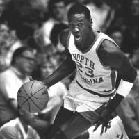 Photo - University of North Carolina All-America guard Michael Jordan drives downcourt against the University of Tennessee-Chattanooga in this Nov. 28, 1983 photo in Chapel Hill.  (AP Photo/Robert Willett) ORG XMIT: APHS215,APHS215