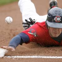 Photo - The RedHawks' Casey Benjamin (17) dives back to first base during the minor league baseball game between the Oklahoma City RedHawks and the New Orleans Zephyrs, Sunday, May 3, 2009, at the AT&T Bricktown Ballpark in Oklahoma City. Photo by Sarah Phipps, The Oklahoman ORG XMIT: KOD