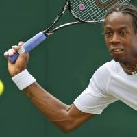 Photo - Gael Monfils of France returns to Jiri Vesely of the Czech Republic during their men's singles match at the All England Lawn Tennis Championships in Wimbledon, London, Thursday, June 26, 2014. (AP Photo/Sang Tan)