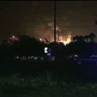 Photo - This frame grab from an Associated Press video shows flames from a gas plant explosion in Tavares City, Fla., Monday July 29, 2013. A series of major explosions at has injured several workers and left others missing. The Orlando Sentinel reported Monday night that Tavares City Administrator John Drury said 10 of 24 people working at Blue Rhino, a propane gas plant, have not been accounted for after the blasts. Lake County Sheriff Gary Borders says the blasts occurred inside the plant and blew the roof off. The newspaper reports that the blasts began about 11 p.m. and continued for about an hour. (AP Photo)