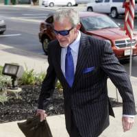 Photo - Indianapolis Colts owner Jim Irsay enters Hamilton County court in Noblesville, Ind., Tuesday, Sept. 2, 2014. Irsay is scheduled to appear in court for a change-of-plea hearing on drug-related charges he faces from a traffic stop in March.  (AP Photo/Michael Conroy)