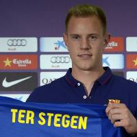 Photo - Marc-Andre Ter Stegen, from Germany, holds his new shirt during his official presentation as new goalkeeper of FC Barcelona at the camp nou stadium in Barcelona, Spain, Thursday, May 22, 2014. (AP Photo/Manu Fernandez)