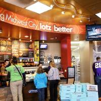 Photo - Customers enjoy the upscale touches at the Midwest City Schlotzsky's, which has a fireplace, media wall with TVs and Wi-Fi and an outdoor fountain and patio. Photos by Jim Beckel, THE OKLAHOMAN
