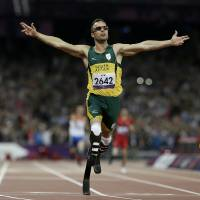 Photo - FILE - In this Saturday, Sept. 8, 2012 file photo, South Africa's Oscar Pistorius wins gold in the men's 400-meter T44 final at the 2012 Paralympics, in London. Pistorius has been arrested after a 30-year-old woman was shot dead at his home in South Africa, early Thursday, Feb. 14, 2013. (AP Photo/Kirsty Wigglesworth, File)
