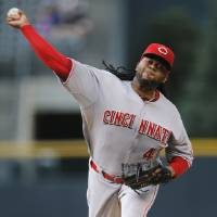 Photo - Cincinnati Reds starting pitcher Johnny Cueto throws to a Colorado Rockies batter during the first inning of a baseball game Friday, Aug. 15, 2014, in Denver. (AP Photo/Jack Dempsey)