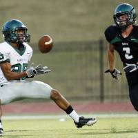 Photo - Edmond Santa Fe's Dale Jefferson, left, makes a touchdown catch in front of Norman North's Keaton Haney during an Aug. 16 scrimmage in Moore.  Photo by Nate Billings, The Oklahoman