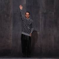 Photo - Fashion designer Damir Doma greats the audience at the end of his fall-winter 2013/2014 men's fashion collection, in Paris, Saturday, Jan. 19, 2013. (AP Photo/Zacharie Scheurer)
