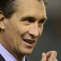 Photo -   FILE - This Oct. 21, 2012 file photo shows former Cincinnati Bengals receiver Cris Collinsworth prior to an NFL football game between the Bengals and Pittsburgh Steelers, in Cincinnati. Collinsworth figures his announcing career benefited from the fact he wasn't a household name as an NFL player. He learned from his mistakes calling games watched by small numbers of fans, slowly working his way up to his current high-profile gig on
