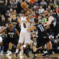 Photo -   Minnesota Timberwolves' Jose Barea (11) and Kevin Love, right, defend a drive by Portland Trail Blazers' Damian Lillard (0) during the first half of an NBA basketball game in Portland, Ore., Friday, Nov. 23, 2012. At left is Timberwolves' Dante Cunningham. (AP Photo/Greg Wahl-Stephens)