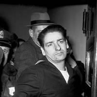 Photo - FILE - In this Feb. 25, 1967 file photo self-confessed Boston Strangler Albert DeSalvo is seen minutes after his capture in Boston. Authorities say DNA tests on the remains of DeSalvo confirm he killed Mary Sullivan, the woman believed to be the serial killer's last victim. DeSalvo admitted to killing Sullivan and 10 other women in the Boston area between 1962 and 1964 but later recanted. He was later killed in prison. (AP Photo, File)