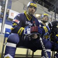 Photo - Jaromir Jagr,  foreground,  sits on the bench during a good-bye match in which his home Czech team of Rytiri Kladno defeated HC Verva Litvinov in Kladno, Czech Rep., on Tuesday, Jan. 8, 2013. Jagr surprised his fans and took part in the match, while many of his NHL colleagues have already departed back to the US and Canada as the NHL lock-out finished. Jagr plays for the Dallas Stars in the US. (AP Photo/CTK, Michal Kamaryt) SLOVAKIA OUT