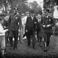 Photo - FILE - In this May 14, 1933 file photo, John D. Rockefeller, Sr. is surrounded by state troopers and admirers as he attended church in Lakewood, N.J. In the early 21st century, members of the economic elite are looking for ways to reduce the nation's growing income inequality for a variety of reasons, from self-interest to pangs of conscience.