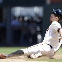 Photo - San Francisco Giants' Brandon Belt slides into second base with a double against the Miami Marlins during the fourth inning of a baseball game on Saturday, June 22, 2013, in San Francisco. (AP Photo/Marcio Jose Sanchez)