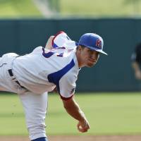Photo - Kansas' Jordan Piche pitches against West Virginia in the first inning of a first-round game in the Big 12 conference baseball tournament in Oklahoma City, Wednesday, May 21, 2014. (AP Photo/Sue Ogrocki)
