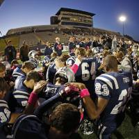 Photo -  The Edmond North team prays before a football game between Edmond North and Moore at Wantland Stadium in Edmond. Photo by Bryan Terry, The Oklahoman Archives   BRYAN TERRY -