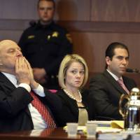 Photo - New Jersey Gov. Chris Christie's former Deputy Chief of Staff Bridget Anne Kelly, center, sits with her attorney Michael Critchley, left, and defense team member attorney Edmund DeNoia, right,  during a hearing Tuesday, March 11, 2014, in Trenton, N.J. Attorneys for Kelly and former Christie campaign manager Bill Stepien were in court to try to persuade a judge not to force them to turn over text messages and other private communications to New Jersey legislators investigating the political payback scandal ensnaring Christie's administration. (AP Photo/The Record of Bergen County, Chris Pedota, Pool)