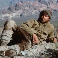 Photo - FILE - In this undated photo, actor Brad Pitt in his role as Austrian mountaineer and former Nazi party member Heinrich Harrer reclines on a mountain ledge during the filming of