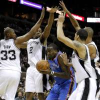Photo - NBA BASKETBALL: Oklahoma City's Kendrick Perkins (5) gets caught between San Antonio's Boris Diaw (33), Kawhi Leonard (2), Daniel Green (4), and Tim Duncan (21) during Game 2 of the Western Conference Finals between the Oklahoma City Thunder and the San Antonio Spurs in the NBA playoffs at the AT&T Center in San Antonio, Texas, Tuesday, May 29, 2012. Photo by Bryan Terry, The Oklahoman