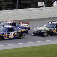 Photo - Chase Elliott (9) drives past Ty Dillon (3) and Erik Jones (20) during the NASCAR Nationwide series auto race at Chicagoland Speedway in Joliet, Ill., Saturday, July 19, 2014. (AP Photo/Nam Y. Huh)