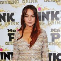 Photo - FILE - In this Oct. 11, 2012 file photo, Lindsay Lohan attends the Mr. Pink Ginseng launch party at the Beverly Wilshire hotel in Beverly Hills, Calif. Los Angeles city prosecutors said Tuesday Dec. 11, 2012 that they will seek to revoke Lohan's probation because the actress has been charged with three misdemeanors stemming from a June car crash. (Photo by Richard Shotwell/Invision/AP, File)