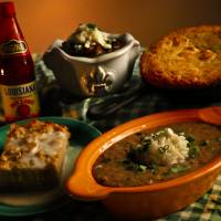Photo - Mardi Gras meal of red beans and rice, gumbo, corn bread and bread pudding in Oklahoma City, Okla. on Tuesday, Feb. 18, 2014.. Photo by Chris Landsberger, The Oklahoman
