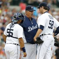 Photo - Detroit Tigers starter Doug Fister, right, is visited on the mound by pitching coach Jeff Jones, center, and catcher Brayan Pena after loading the bases in the fourth inning of a baseball game against the Boston Red Sox, Friday, June 21, 2013, in Detroit. (AP Photo/Duane Burleson)