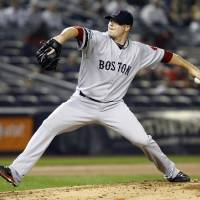 Photo -   Boston Red Sox starting pitcher Jon Lester delivers in the first inning of a baseball game against the New York Yankees at Yankee Stadium in New York, Tuesday, Oct. 2, 2012. (AP Photo/Kathy Willens)
