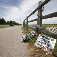 Photo - A makeshift memorial marks the location of a traffic accident. Such markers are common in Oklahoma. Photo by Steve Gooch, The Oklahoman