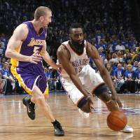 Photo - Oklahoma City's James Harden (13) tries to get past Los Angeles' Steve Blake (5) during Game 1 in the second round of the NBA playoffs between the Oklahoma City Thunder and the L.A. Lakers at Chesapeake Energy Arena in Oklahoma City, Monday, May 14, 2012. Photo by Sarah Phipps