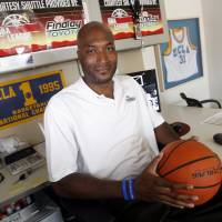 Photo -  In this Sept. 18, 2010, file photo, former UCLA basketball player Ed O'Bannon Jr. sits in his office in Henderson, Nev.  Five years after the former UCLA star filed his antitrust lawsuit against the NCAA, it goes to trial Monday, June 9, 2014,  in a California courtroom.  (AP Photo/Isaac Brekken, File)