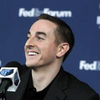 Photo -   Memphis Grizzlies basketball new chairman Robert Pera smiles during a press conference in Memphis, Tenn., Monday, Nov. 5, 2012. (AP Photo/Lance Murphey)