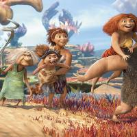 Photo - From left, Thunk, voiced by Clark Duke, Gran, voiced by Cloris Leachman, Ugga, voiced by Catherine Keener, who is holding Sandy, voiced by Randy Thom, Eep, voiced by Emma Stone and Grug, voiced by Nicolas Cage, in a scene from